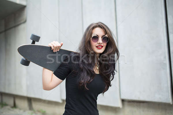 Stylish teenager girl with a longboard Stock photo © bezikus