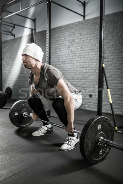 Crossfit training barbell atletisch man baard Stockfoto © bezikus