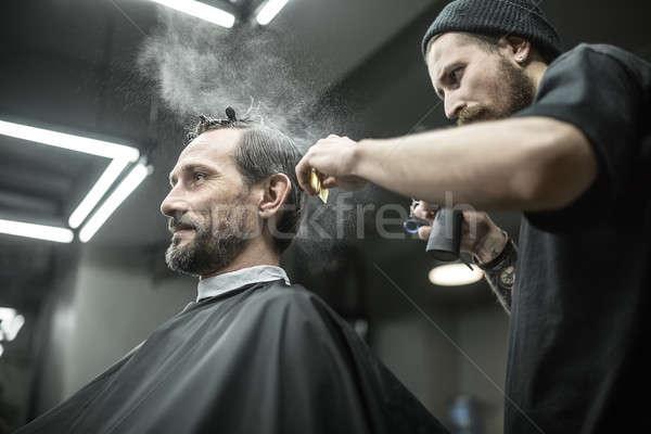 Barbero aerosol botella de moda hombre barba Foto stock © bezikus