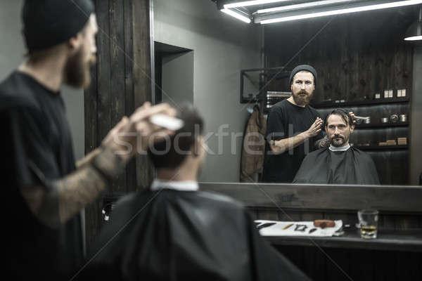 Elegáns férfi szándék fodrász nagy szakáll Stock fotó © bezikus