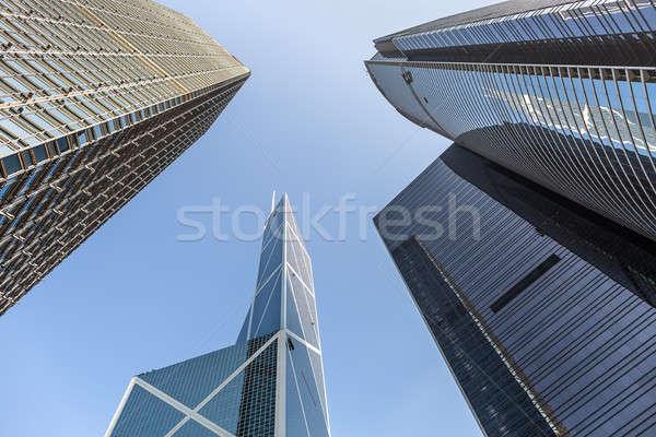 Felhőkarcolók kék ég modern Szingapúr kilátás alatt Stock fotó © bezikus