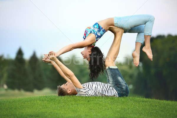 Man and woman on grass Stock photo © bezikus