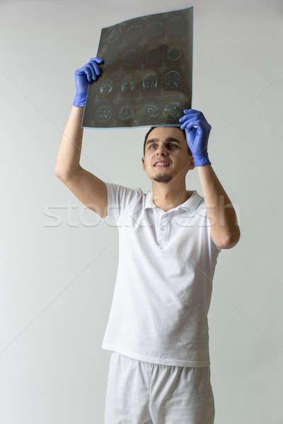 Orvos tomográfia fiatal fehér egyenruha kék Stock fotó © bezikus