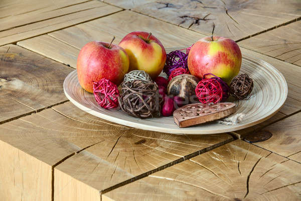 apples in clay plate on wooden table. Stock photo © bezikus