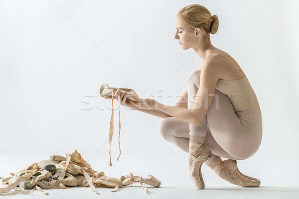 Stock photo: Ballerina with many pointe shoes