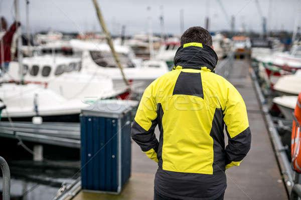 男 徒歩 ドック 神秘的な 黄色 ジャケット ストックフォト © bezikus
