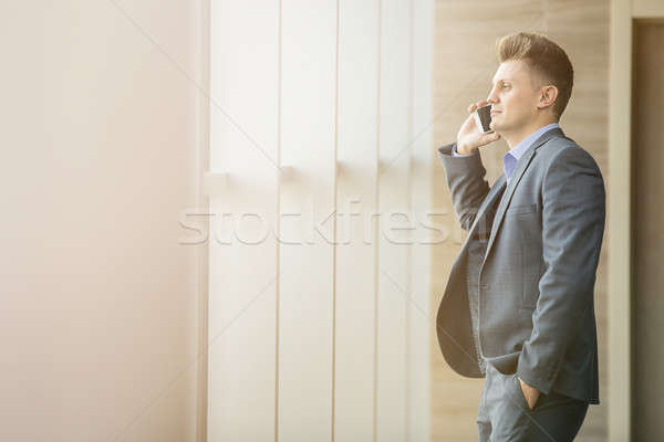 Cute business man in a strict black suit Stock photo © bezikus