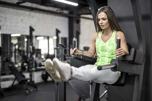 Training of athletic girl in gym Stock photo © bezikus