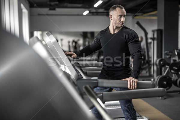 Mighty man on treadmill Stock photo © bezikus