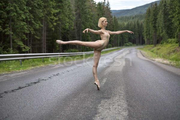 Ballerina posing outdoors Stock photo © bezikus