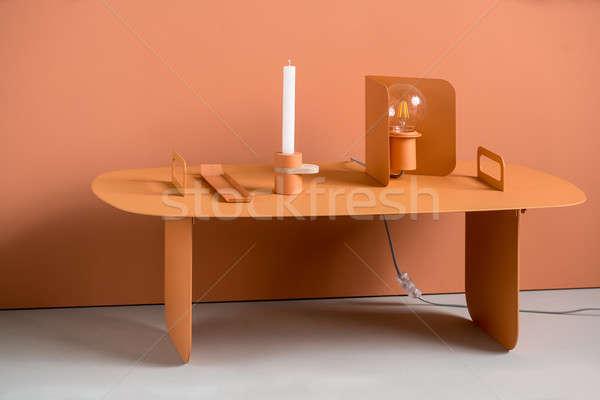 Metal orange table with lamp and accessories Stock photo © bezikus