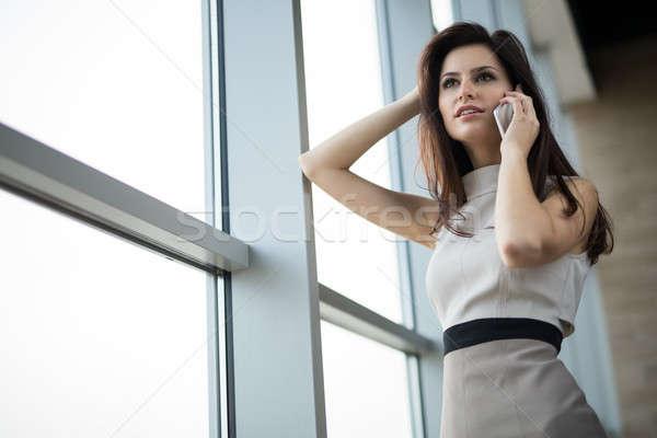 Dark-haired girl in a light dress Stock photo © bezikus