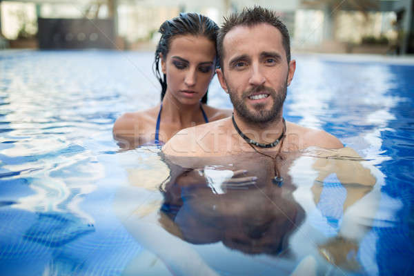 Couple in the pool Stock photo © bezikus