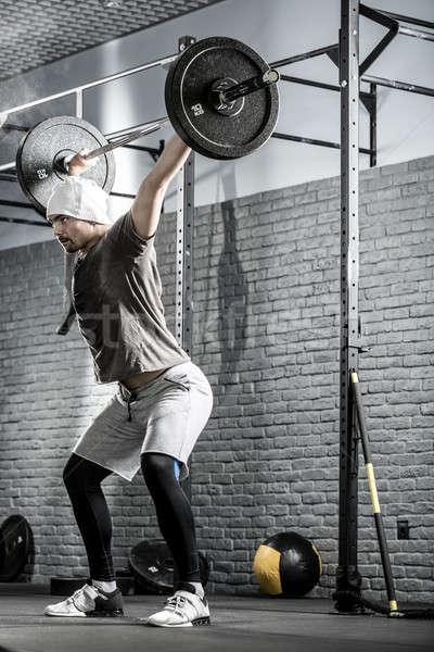 Crossfitの トレーニング バーベル 信じられない 男 あごひげ ストックフォト © bezikus
