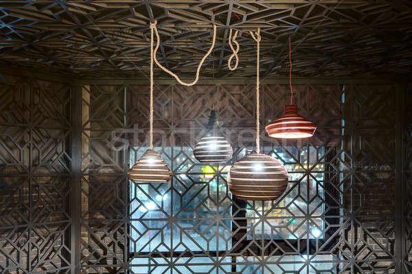 Hanging glowing lamps Stock photo © bezikus