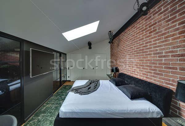 современный стиль спальня современный кирпичная стена зеленый ковер Сток-фото © bezikus