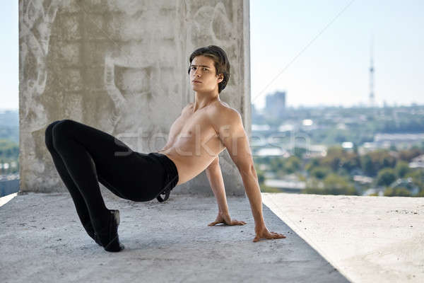 Ballet dancer posing at unfinished building Stock photo © bezikus