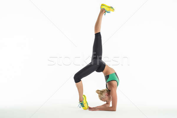 Ritmisch gymnast oefening studio mooie sportkleding Stockfoto © bezikus