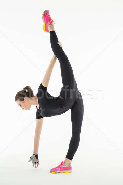 Rhythmic gymnast doing exercise in studio. Stock photo © bezikus