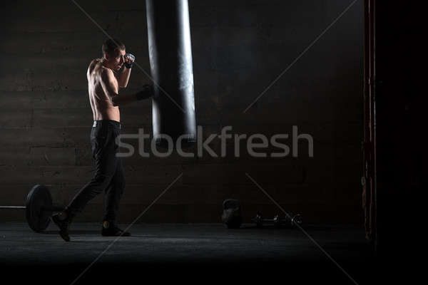 young boxer in light weight with bare-chested Stock photo © bezikus