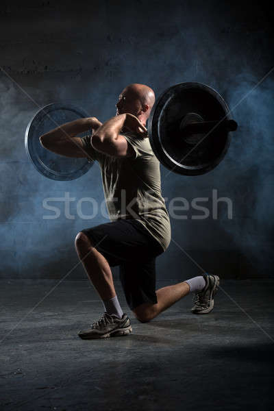 Bald athlete doing exercise with a barbell Stock photo © bezikus