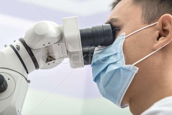 Dişçi diş mikroskop genç klinik Stok fotoğraf © bezikus