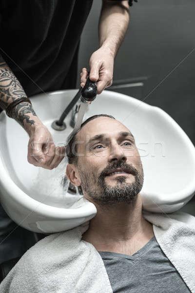 Washing head in barbershop Stock photo © bezikus
