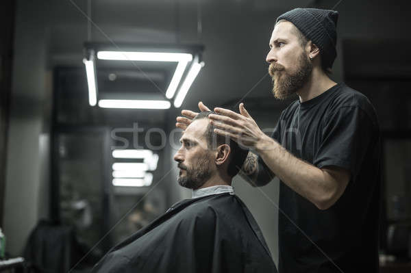 Making hairstyle in barbershop Stock photo © bezikus