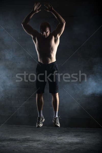 Bald athlete topless jumping up Stock photo © bezikus