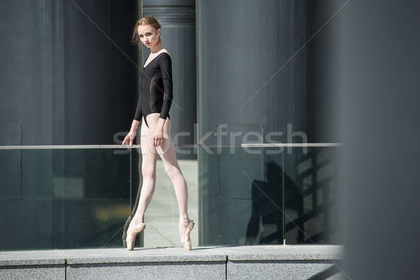 Young graceful ballerina in black bathing suit on a background o Stock photo © bezikus