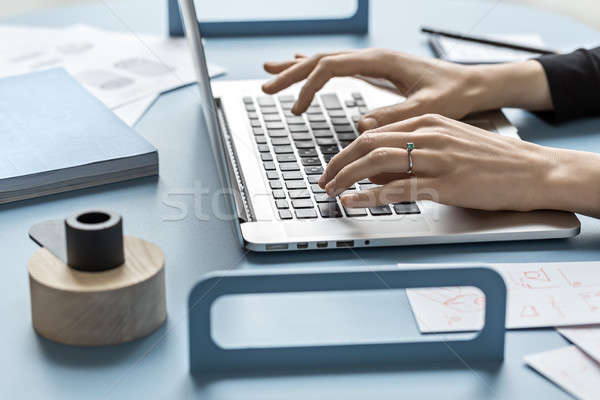 Girl using laptop in office Stock photo © bezikus