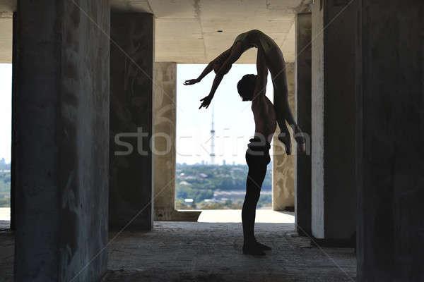Ballet dancers posing at unfinished building Stock photo © bezikus