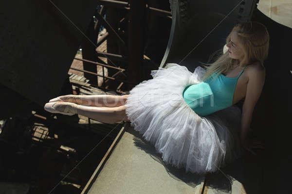 Ballerina sitting on the edge of bridge Stock photo © bezikus