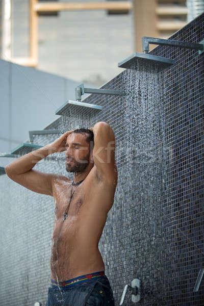 Man in shower Stock photo © bezikus