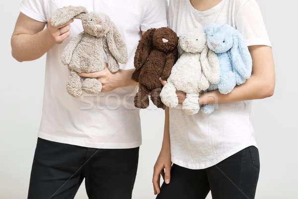 Homme femme jouet lapins couple blanche Photo stock © bezikus
