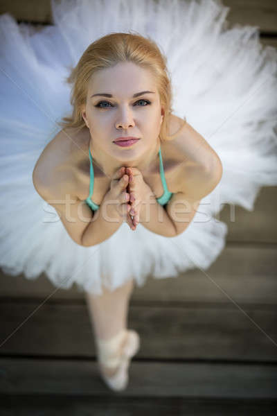 Close portrait of a cute ballerina in white tutu and blue bathin Stock photo © bezikus