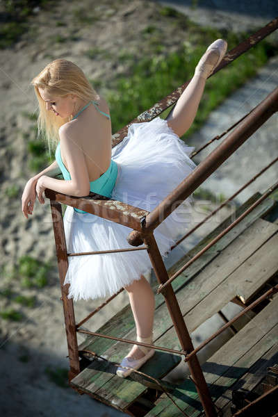 Soft ballerina with blond hair in a white tutu standing on old r Stock photo © bezikus