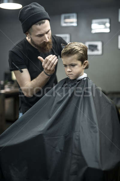 Kid's hair styling in barbershop Stock photo © bezikus