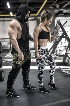 Athletic girls training in gym Stock photo © bezikus