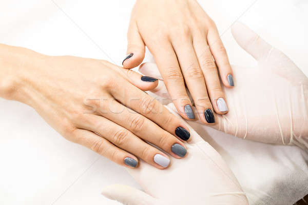 Photo close-up of a beautiful stylish manicure with multicolored Stock photo © bezikus