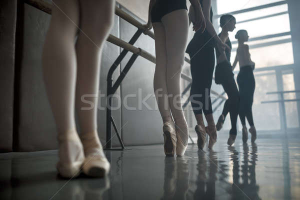 Dancers stands by the ballet barre. Stock photo © bezikus