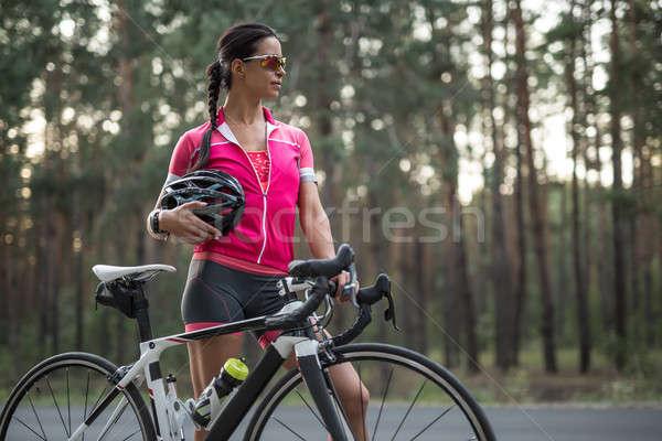 Femenino ciclista aire libre joven moto carretera Foto stock © bezikus
