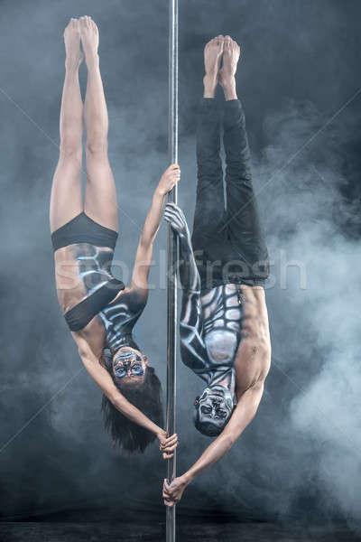 Posing of pole dance couple in dark studio Stock photo © bezikus