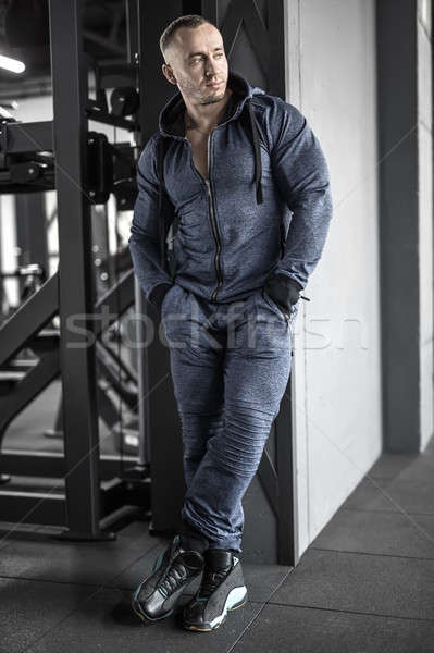 Muscular man posing in gym Stock photo © bezikus
