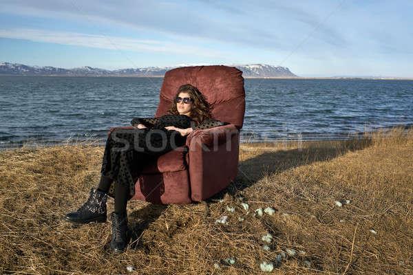 Girl sits on armchair outdoors Stock photo © bezikus