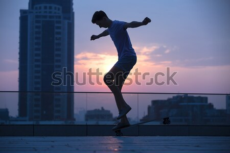 подростку Перейти городского город закат Сток-фото © bezikus