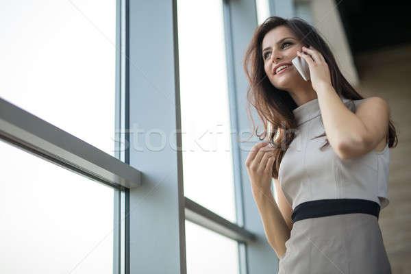 Dark-haired girl in a dress Stock photo © bezikus