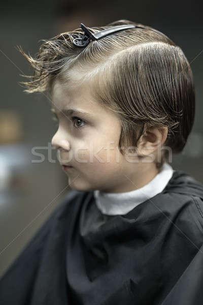 Portrait of little boy in barbershop Stock photo © bezikus