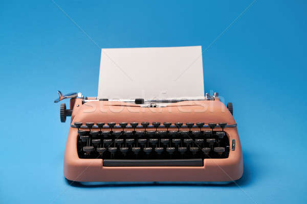 Retro typewriter coral color in studio, studio shoot. Stock photo © bezikus
