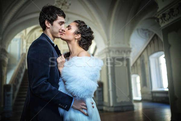 Portrait of happy wedding couple in classic interior Stock photo © bezikus